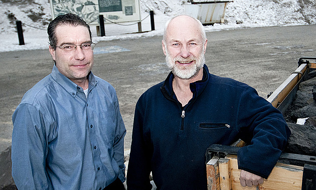 two men standing in front of a building in Sparwood BC