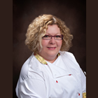 blond woman wearing chef's jacket