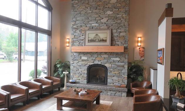 The spacious and comfortable waiting area features a beautiful natural stone fireplace.