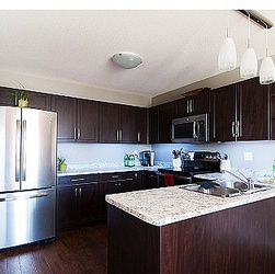 A kitchen designed by Interior Designs by Adrienne.