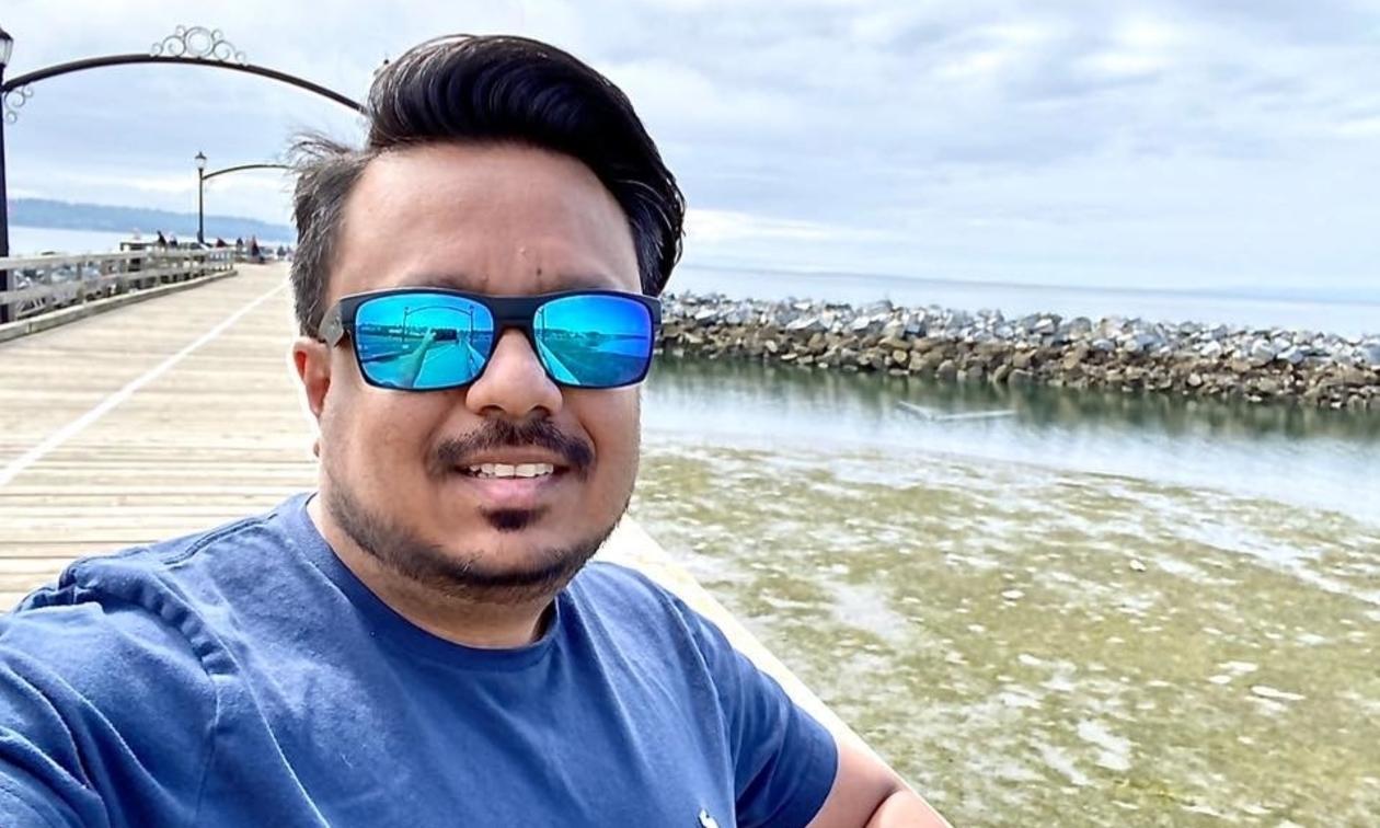 Kushal Patel at a pier wearing sunglasses