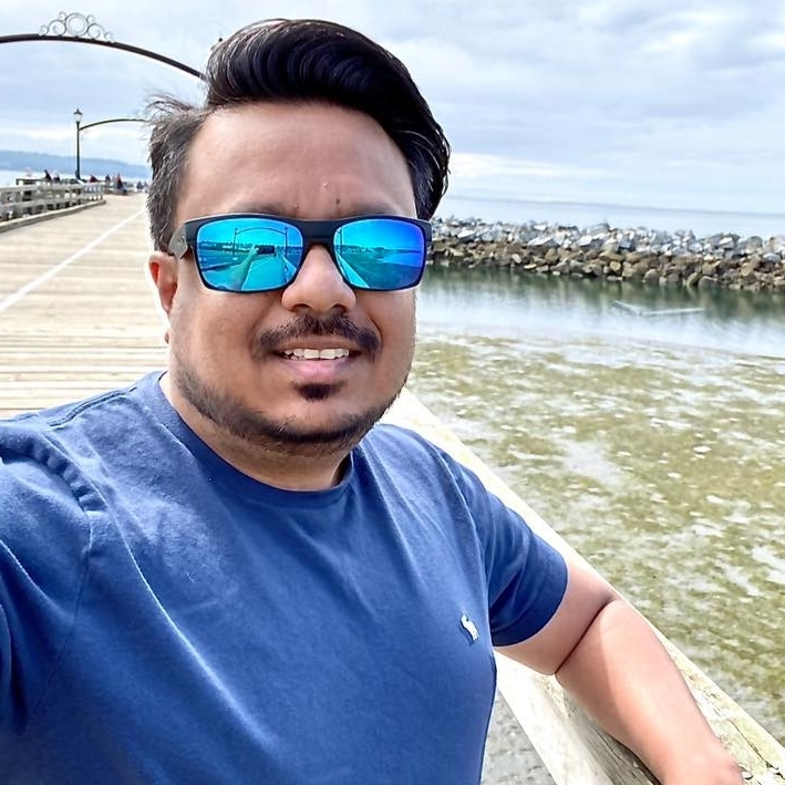 Kushal Patel at a pier wearing sunglasses
