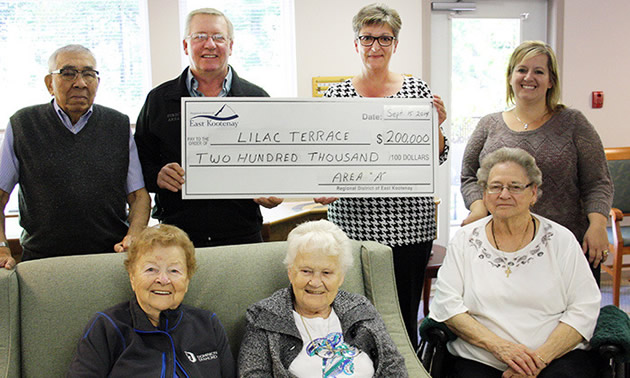 A group of people holding a cheque