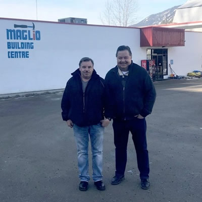 Owners of Maglio Building Centre standing outside store.