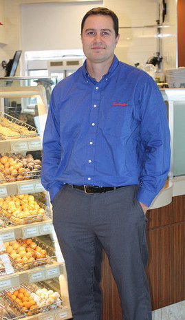 Mark Nelson standing next to the counter in the new Tim Hortons in Sparwood, B.C.