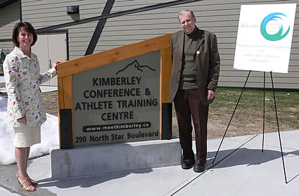 Photo of two people standing next to the Kimberley Conference and Athlete Training sign