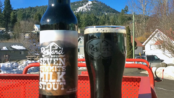 Picture of bottle and full glass of 7 Summits Milk Stout.