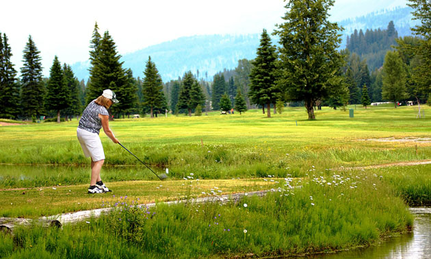 Person golfing at Mountain Meadows Golf Club.