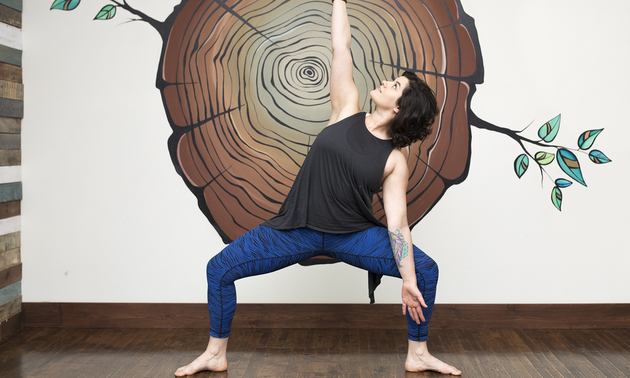 Drea Dokuchie doing yoga in her studio