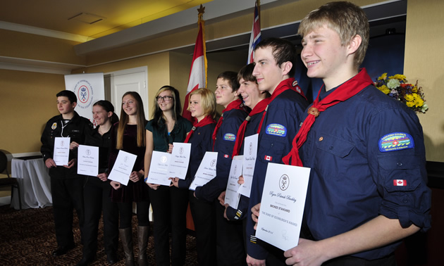 Nine youth holding their Duke of Edinburgh Award