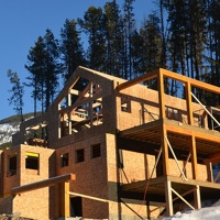 A home being constructed on Trapper's Ridge at Panorama Mountain Resort.