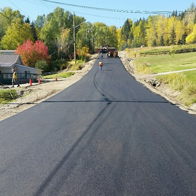 Photo of newly paved road in photo.