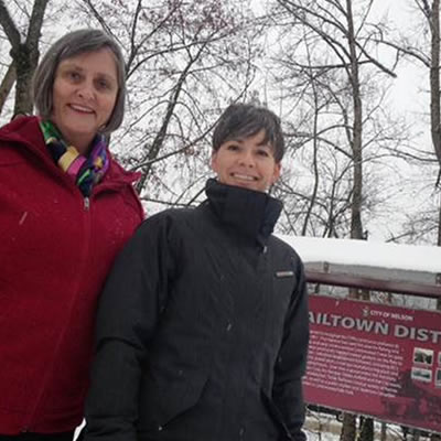Nelson Mayor Deb Kozak and Pam Mierau, Manager of Development Services at the gateway to the Railtown District.