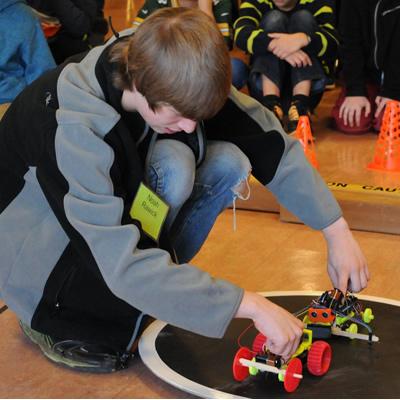Noah Rawick sets up a Robot Battle.