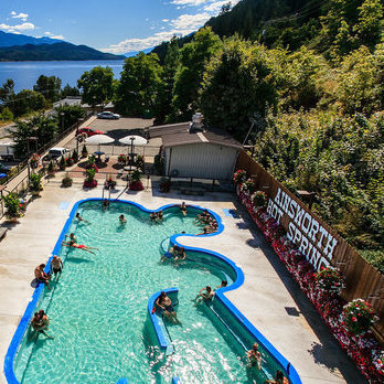The photo shows the large hot pool at Ainsworth Hot Springs.