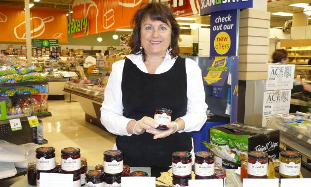 Faith Saunders offers customers at Save-On-Foods in Cranbrook a taste test of some of her jams and jellies.