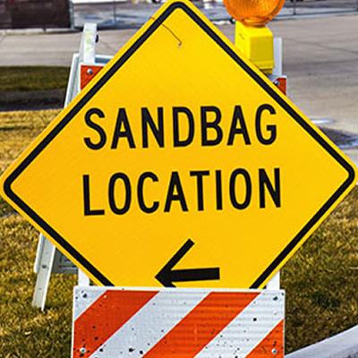 Yellow sandbag location sign.