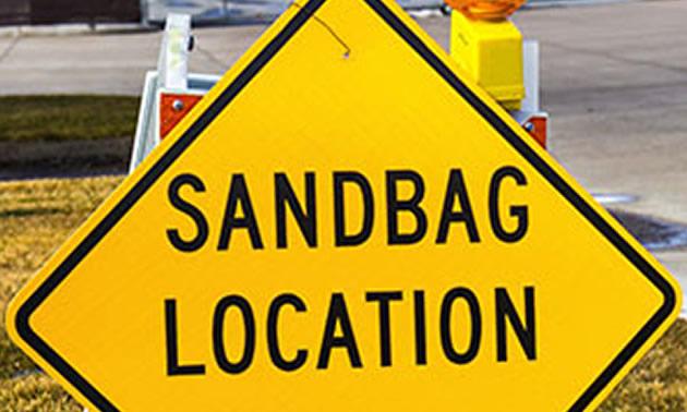 Yellow sandbag location sign.