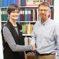 Selkirk College is receiving Trust support to help it implement its new Rural Pre-Medicine Program. (L-R) Elizabeth Lund, Selkirk College Chemistry Instructor and Rural Pre-Medicine Program Coordinator, and Kelvin Saldern, Trust Community Liaison.