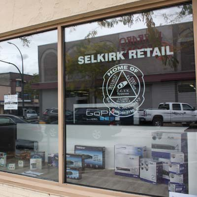 The front window of the new Selkirk Security retail store in downtown Trail.