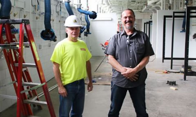 Yellowridge project manager Paul Bradford (left) and Selkirk College School of Industry & Trades chair Rob Schwarzer have been charged with making sure the educational programs run smoothly while construction takes place in the Silver King Campus shops.