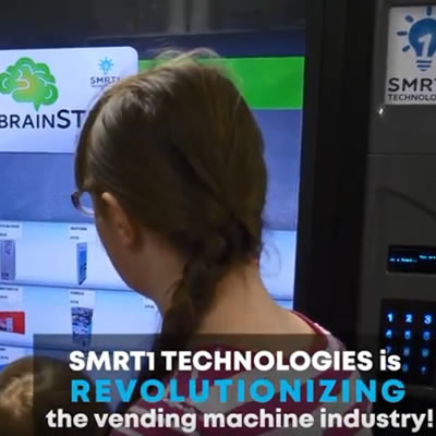 Girl and man using a Smart touch-based vending machine.