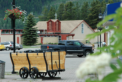 Vintage rail car filled with coal in downtown Sparwood