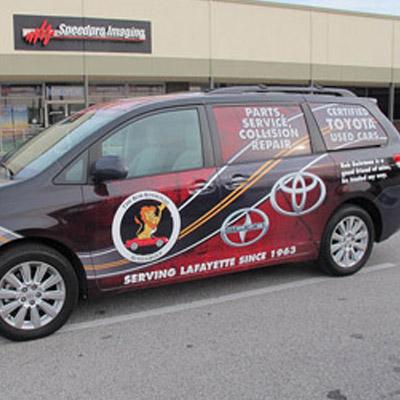 Van that is wrapped in advertising.