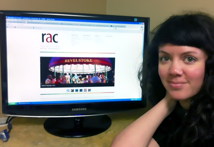 Tennille Barber sits with a computer monitor which displays the new RAC website.
