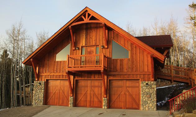 exterior of a timber frame garage with 3 garage doors
