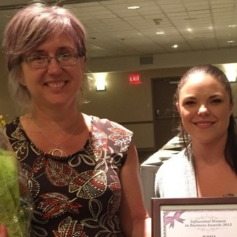 Cutline: Rachel Ross (L), vice-president of Mandala Homes in Nelson, was a winner in the 2015 Influential Women in Business Awards, West Kootenay division, sponsored by Kootenay Business magazine. The magazine's sales rep, Kyla MacNeil, was happy to present the award.