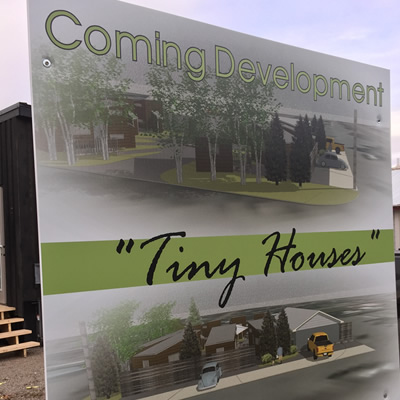 A billboard advertising the coming tiny home development.
