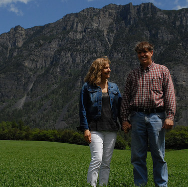Ben and Claudia Herrera are standing in one of their wheat fields in Creston, B.C.
