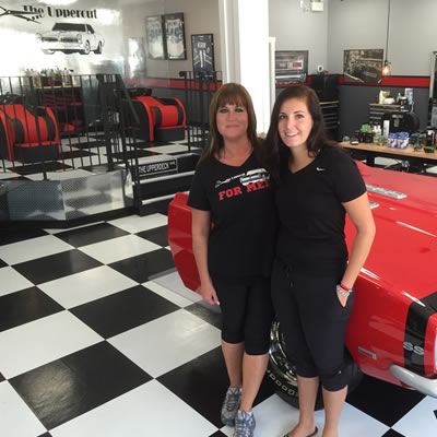 Picture of Bonnie McCormack and her daughter Kayley, at her new hair salon, The Upper Cut for Men.