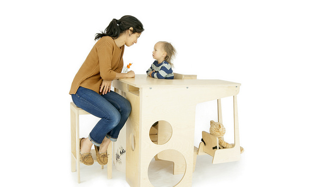Keiko Lee-Hem sits at the UpUp Play Tower with her son, Eli.