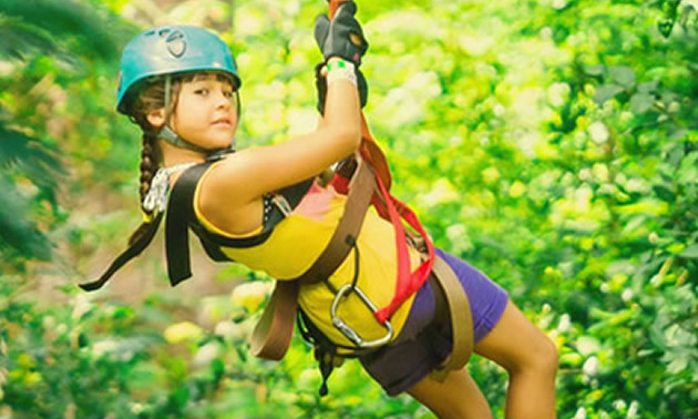 Photo of young girl on zipline.
