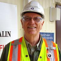 Wally Penner with a white hard hat on and high vis gear at the Waneta Expansion.