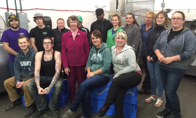 Top Hand Supplies Ltd. (Pets Go Raw) in Cranbrook is Kootenay Business's Manufacturer of the year. Pictured are CEO/general manager Sherin Laurie and staff.