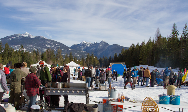 people at the winter festival barbecuing hotdogs