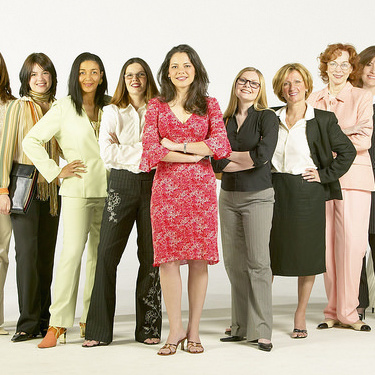 A group of business women all standing together.